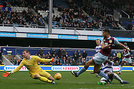 Rudy Gestede of Aston Villa (R) sees his shot at goal  saved by goalkeeper Alex Smithies of Queens Park Rangers (L). EFL Skybet championship match, Queens Park Rangers v Aston Villa at Loftus Road Stadium in London on Sunday 18th December 2016.<br /> pic by Steffan Bowen, Andrew Orchard sports photography.