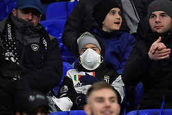 Football fans wear masks amid coronavirus fear during UEFA Champions League round of 16 first leg Olympique Lyonnais (OL) v Juventus Turin football match at the Parc Olympique Lyonnais stadium in Decines-Charpieu near Lyon, central-eastern France, on February 26, 2020. Photo by Christian Liewig /ABACAPRESS.COM