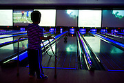 Jordan Strauss (4) bowls during the 6th annual Zweig Family End of School Year Bash at 300 Dallas in Addison on Sunday, April 14, 2013. (Cooper Neill/The Dallas Morning News)