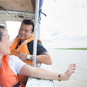 CAPTION: Dr Neto and Mariane Goes, Smile Train's Country Director in Brazil, share a light moment as they speed along the Rio Marañón to the small town of Benjamin Constant. LOCATION: Rio Marañón, near Tabatinga, Amazonas, Brazil. INDIVIDUAL(S) PHOTOGRAPHED: Mariane Goes (left) and Dr Joaquim Neto (right).