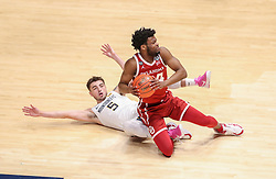 Feb 13, 2021; Morgantown, West Virginia, USA; Oklahoma Sooners guard Elijah Harkless (24) and West Virginia Mountaineers guard Jordan McCabe (5) get tangled up a mid court during the first half at WVU Coliseum. Mandatory Credit: Ben Queen-USA TODAY Sports