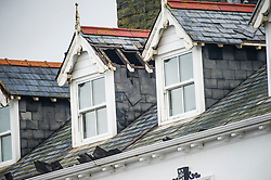 © London News Pictures. 02/03/2016. Aberystwyth, UK. <br /> Slate  tiles blown off a roof  in the town Aberystwyth as Storm Jake hits the Welsh coastline. 70mph gusts of wind have torn roof-slates off several of the older properties on seafront and brought down trees in the town centre. Photo credit: Keith Morris/LNP