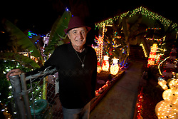 """Joe Brock leads a tour of the Christmas decor that adorns his Martinez, Calif. home, Tuesday, Dec. 22, 2015. Brock, the so-called """"Christmas Guy,"""" and his wife Sharon staged a holiday spectacle for 28 years that drew visitors from miles around, until a fire destroyed their home in 2012. Now they're back, and sightseers are back as well. (D. Ross Cameron/Bay Area News Group)"""