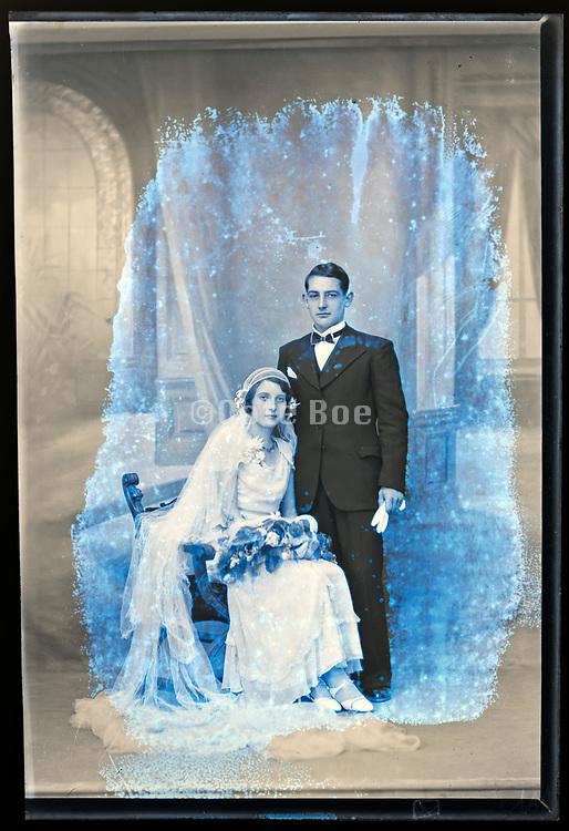 deteriorating wedding portrait in studio with classic interior background France circa 1930s