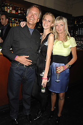 Left to right, CHARLES DELEVIGNE, POPPY DELEVIGNE and PANDORA DELEVIGNE at a leaving party for Poppy Delevigne who is going to New York to persue a career as an actress, held at Chloe, Cromwell Road, London on 25th January 2007.<br />