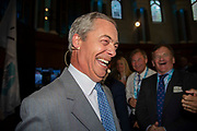 Brexit Party leader Nigel Farage laughs with party members and delegates at an event to introduce prospective parliamentary candidates in central London, United Kingdom on 27th August, 2019.