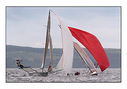 The 2004 Skiff Nationals at Largs held by the SSI.<br /> <br /> Andy Richards, Andy Fairlie and Dave Richards onboard Radii overtaking Base 1 helmed by Rob Dulson.<br /> <br /> Marc Turner / PFM Pictures