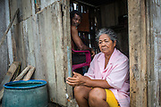 2016/10/05 - Muisne, Ecuador: Antonia Gonzales and Alessandro Campos, on their home in the island of Muisne, Ecuador, 5th October 2016. They live in that house for more than 40 years and they refuse to abandon it, even if there is pressure from the Government since it is consider a high-risk area. It was their second earthquake and they survived both of them, so they aren't scare of anything, they say. Further more, they claim that the island is their home and they will not leave it because they don't know any other way of living. (Eduardo Leal)