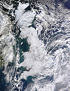 United Kingdom of Great Britain under a cover of snow. Photographed by Satellite