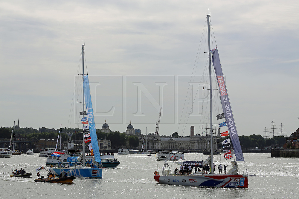 © Licensed to London News Pictures. 01/09/2013.  Photos of vessels taking part in the Clipper Race. The 11-month round the world race started today at Tower Bridge. The lead vessels in the parade of sail are seen here with the Old Royal Naval College and Cutty Sark at Greenwich in the background. Credit : Rob Powell/LNP