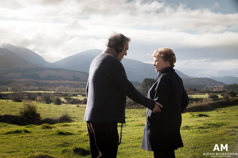 """Philomena Film  2014<br /> Judi dench & Steve Coogan, Adapted Screenplay, Best Picture, Philomena.<br /> <br /> Philomena is the true story of one mother's search for her lost son. When she falls pregnant as a teenager in Ireland in 1952, Philomena Lee (played by Judi Dench) was sent to the convent of Roscrea to be looked after as a """"fallen woman"""". Her baby was only a toddler when he was whisked away by the nuns to America for adoption. Philomena spent the next fifty years searching in vain for her son.<br /> <br /> The film was developed with the support of  BBC Films, the BFI and Pathé.<br /> <br /> Filmed partly in location in Northern Ireland the Mourne Moutnains served as the backdrop for Roscrea, Co Tipperary. This photograph featuring  Dame Judi Dench was taken at the base of the Mourne Mountains and is one of the most memorable scenes of the film. Film Making, Film Posters, Film Stills, Film Stills Photography, Film Stills Photographer"""