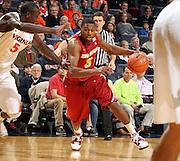 Dec. 30, 2010; Charlottesville, VA, USA; Iowa State Cyclones forward Melvin Ejim (3) drives past Virginia Cavaliers center Assane Sene (5) during the game at the John Paul Jones Arena. Mandatory Credit: Andrew Shurtleff