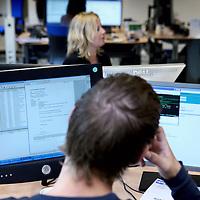 Nederland, Leeuwarden , 16 mei 2011..Medewerker van Achmea aan het werk op het klantcontactcenter..Foto:Jean-Pierre Jans