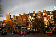 Evening light falling on local buildings in Moseley in Birmingham, England, United Kingdom. Moseley is a suburb of south Birmingham, England, 3 miles south of the city centre.