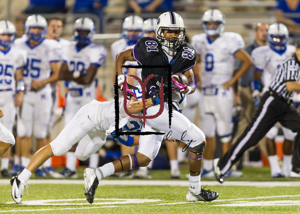 Cedar Ridge running back Raymond Racine races for a first down against MacArthur Friday night at Kelly Reeves Athletic Complex.  Cedar Ridge beat MacArthur 58-57 in double overtime,