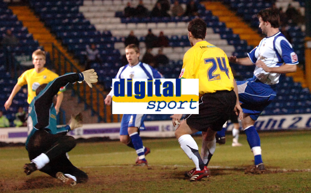 Photo: Paul Greenwood.<br />Bury v Hereford United. Coca Cola League 2. 30/01/2007. Hereford's Steve Guinan shoots on goal as Bury keeper Andy Warrington dives to save