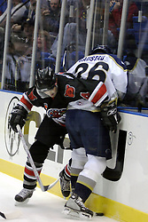 21 October 2006: Jared Bourassa and B.J. Gaustad battle at the glass. Rockford finished ahead of Bloomington 5 goals to 3. The Rockford IceHogs met the Bloomington Prairie Thunder at the U.S. Cellular Coliseum in Bloomington Illinois.<br />