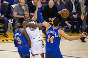 Golden State Warriors forward Andre Iguodala (9) passes the ball through the New York Knicks defense at Oracle Arena in Oakland, Calif., on May 2, 2017. (Stan Olszewski/Special to S.F. Examiner)