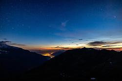 THEMENBILD - Der Komet C/2020 F3 (NEOWISE) im dreiländereck des Nationalpark Hohe Tauern, über der Grossglockner Hochalpenstrasse, links die Lichter von Zell am See, am Montag 20 Juli 2020. Der Komet wurde am 27. März 2020 im Rahmen des Projekts NEOWISE durch das Weltraumteleskop WISE entdeckt // The comet C / 2020 F3 (NEOWISE) in the border triangle of the Hohe Tauern National Park, above the Grossglockner Hochalpenstrasse, the lights of Zell am See on the left. Salzburg, Austria on Monday 20 July 2020. The comet was discovered on March 27, 2020 as part of the NEOWISE project by the WISE space telescope. EXPA Pictures © 2020, PhotoCredit: EXPA/ Johann Groder