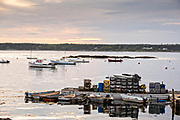 The lobster docks and pier piled high with traps at sunrise at Five Islands Harbor, Maine.