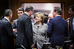 Angela Merkel, Germany's chancellor, center, speaks with Petr Necas, prime minister of the Czech Republic, left, and David Cameron, the U.K.'s prime minister, right, during the EU Summit, at the European Council headquarters in Brussels, Belgium on Thursday, Dec. 13, 2012. (Photo © Jock Fistick)