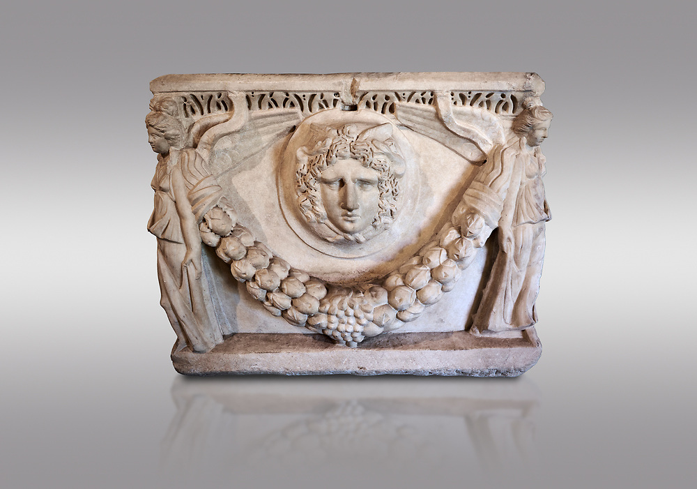 End panel of a Roman relief garland  sculpted sarcophagus, style typical of Pamphylia, 3rd Century AD, Konya Archaeological Museum, Turkey. Against a grey background .<br /> <br /> If you prefer to buy from our ALAMY STOCK LIBRARY page at https://www.alamy.com/portfolio/paul-williams-funkystock/greco-roman-sculptures.html . Type -    Konya     - into LOWER SEARCH WITHIN GALLERY box - Refine search by adding a subject, place, background colour, museum etc.<br /> <br /> Visit our ROMAN WORLD PHOTO COLLECTIONS for more photos to download or buy as wall art prints https://funkystock.photoshelter.com/gallery-collection/The-Romans-Art-Artefacts-Antiquities-Historic-Sites-Pictures-Images/C0000r2uLJJo9_s0