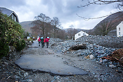 © Licensed to London News Pictures. 08/12/2015. Glen ridding UK. Picture shows water damaged roads in the centre of Glenridding. The village of Glenridding has been cut of from the outside world for four days with no water, electricity or telephone lines after huge torrents of water from the surrounding mountains destroyed roads leading to it & flooded the village centre. Photo credit: Andrew McCaren/LNP