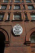 Guinness Trust Buildings AD1892 in Belgravia, on 9th April 2017 in Knightsbridge, London SW3, England. The Guinness Trust was founded in 1890 by Edward Guinness, 1st Earl of Iveagh, a great grandson of the founder of the Guinness Brewery, to help homeless people in London and Dublin. He donated £200,000 to set up the Guinness Trust in London. Nowadays The Guinness Partnership owns and manages nearly 60,000 homes across England, providing services for 120,000 customers and care services for 10,000 people.