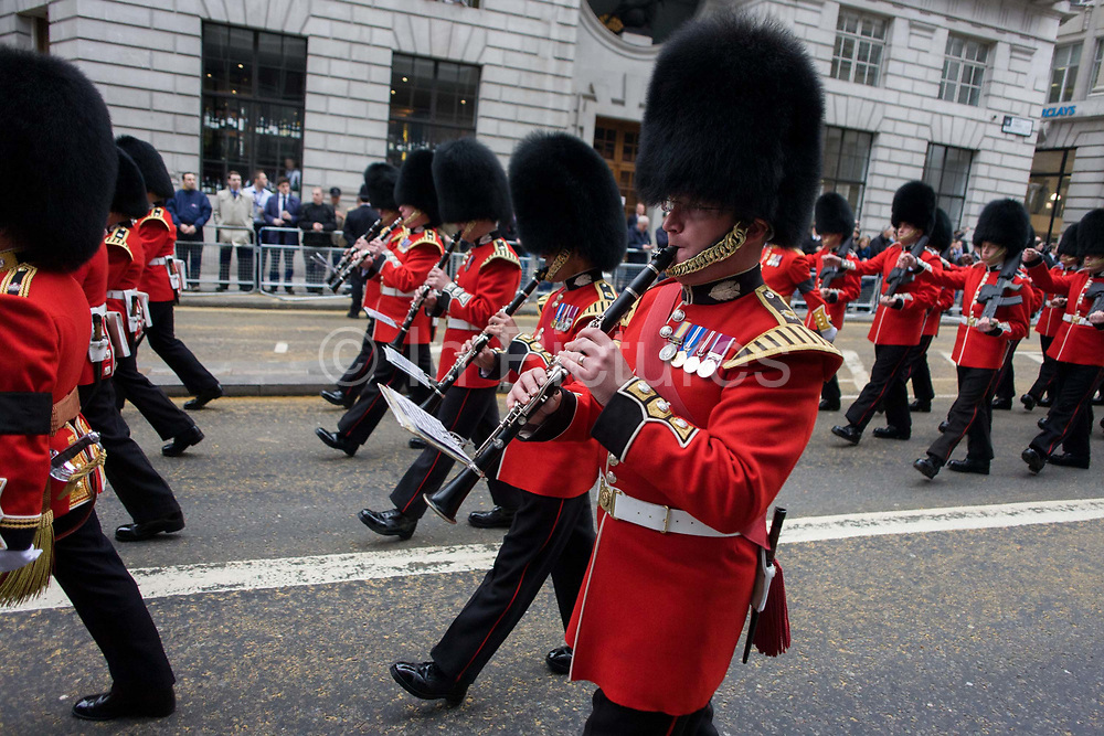 Marching guardsmen before the funeral of Margaret Thatcher. Draped in the union flag and mounted on a gun carriage, the coffin of ex-British Prime Minister Baroness Margaret Thatcher's coffin travels along Fleet Street towards St Paul's Cathedral in London, England. Afforded a ceremonial funeral with military honours, not seen since the death of Winston Churchill in 1965, family and 2,000 VIP guests (incl Queen Elizabeth) await her cortege. Margaret Hilda Thatcher, Baroness Thatcher (1925- 2013) was a British politician who was thePrime Minister of the United Kingdomfrom 1979 to 1990 and theLeader of the Conservative Partyfrom 1975 to 1990, the longest-serving British Prime Minister of the 20th century and the only woman to have held the office to date.