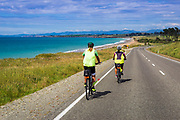 Cyclists on the Otago Coast, Kakanui, Otago, South Island, New Zealand