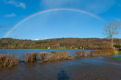 © Licensed to London News Pictures. 19/12/2020. Whitney-on-Wye, Herefordshire, UK. A rainbow is seen over the floods at Whitney-on-Wye in Herefordshire, UK. The river Wye breaks it's banks at Whitney-on-Wye, in Herefordshire, UK. Photo credit: Graham M. Lawrence/LNP