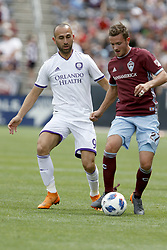 April 29, 2018 - Commerce City, Colorado - Colorado Rapids defender Deklan Wynne (27) attempts to protect the ball from Orlando City SC forward Justin Meram (9) in the first half of action in the MLS soccer game between Orlando City SC and the Colorado Rapids at Dick's Sporting Goods Park in Commerce City, Colorado (Credit Image: © Carl Auer via ZUMA Wire)