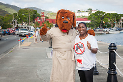 Celia Carroll greets runners with McGruff the Crime Dog.  Virgin Islanders gear up for the 2-mile Virgin Islands Walk/Run Against Gun Violence along the Charlotte Amalie Waterfront.   Proceeds from the event go to benefit the Jason Carroll Memorial Fund for college scholarships.  St. Thomas, VI.  22 May 2016.  © Aisha-Zakiya Boyd