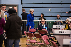 Maidenhead, UK. 13 December, 2019. Former Prime Minister Theresa May (Conservative) and her husband Philip May observe proceedings at the general election count for the Maidenhead constituency.