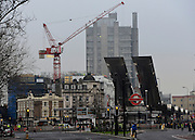 © Licensed to London News Pictures. 16/01/2013. CITY/TOWN e.g Windsor, UK A crane near to the cordened off scene. Helicopter crashes into a crane on a building in Central London today 16th January 2013. The crane is badly damaged as is hanging from the building.  Photo credit : Stephen Simpson/LNP