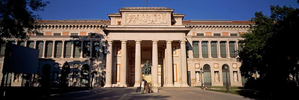 SPAIN, MADRID, PRADO MUSEUM Main facade of museum and statue of Velazquez on Paseo de Prado