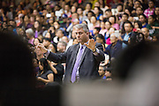 Joe Reichert conducts the Milpitas Unified School District's 11th Annual Music Festival in front of a full house at Milpitas High School in Milpitas, California, on April 10, 2014. (Stan Olszewski/SOSKIphoto)