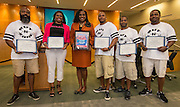 Trustee Wanda Adams recognizes employees of Kut-N-Zone during a meeting of Houston ISD Board of Trustees, September 8, 2016.