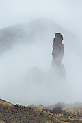 Towering spire in fog, Shohone National Forest, Wyoming