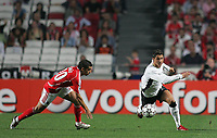 Photo: Lee Earle.<br /> Benfica v Manchester United. UEFA Champions League, Group F. 26/09/2006. United's Cristiano Ronaldo (R) slips on the wet surface as Simao closes in.