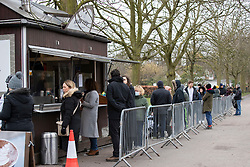 © Licensed to London News Pictures. 31/01/2021. London, UK. Members of the public queue at the Park View Coffee Cabin in Greenwich Park, South East London. A national lockdown is in place in England to attempt to reduce the spread of a new strain of COVID-19 . Photo credit: George Cracknell Wright/LNP