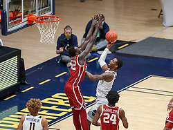 Feb 13, 2021; Morgantown, West Virginia, USA; West Virginia Mountaineers forward Gabe Osabuohien (3) shoots over Oklahoma Sooners forward Kur Kuath (52) during the first half at WVU Coliseum. Mandatory Credit: Ben Queen-USA TODAY Sports