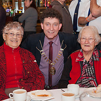 Mayor of Ennis Johnny Flynn with Ann McCullough and May Cahill both from Ennis at the Ennis Garda Christmas Party for the Elderly on Thursday