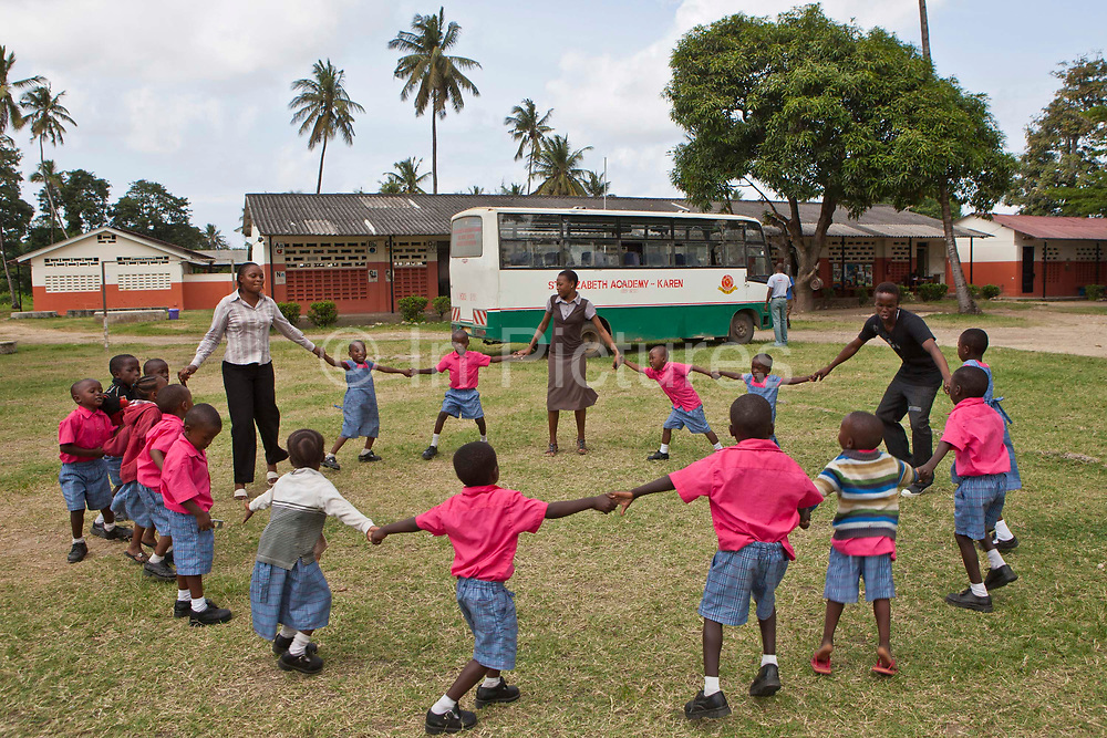 Children doing a physical education class at the Wema Centre, Mombassa, Kenya. Wema provide a rehabilitation program for street children; poor, disadvantaged youth; and, orphaned and vulnerable children affected by poverty. Emotional support and education enables the children reintegration back into society.