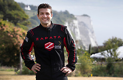 © Licensed to London News Pictures. 04/08/2019. Dover, UK. French inventor Franky Zapata smiles as he stands at St Margarets Bay near Dover after crossing the English Channel on his jet-powered hoverboard. He made the 35km crossing with a refueling stop mid channel to reach the English coast after setting off at 6:15am French time. Photo credit: Peter Macdiarmid/LNP