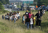 Silver Lake firefighter Jeff Jaques, right, leads campers to a bus waiting in the Best Buy parking lot after their bus was involved in an accident on Route 17 in the Town of Wallkill on Aug. 16, 2007.