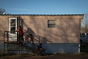 (From L) Siblings Carolina, Rachel and Bayron, children of Orfa, a migrant from Honduras seeking asylum, head back inside the family's rented trailer after playing outside in Texico, New Mexico, U.S., November 28, 2018.