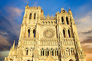 Gothic Cathedral of Notre-Dame, Amiens, France . The Cathedral Basilica of Our Lady of Amiens or simply Amiens Cathedral, is a Roman Catholic  cathedral the seat of the Bishop of Amiens. It is situated on a slight ridge overlooking the River Somme in Amiens. Amiens Cathedral, was built almost entirely between 1220 and c.1270, a remarkably short period of time for a Gothic cathedral, giving it an unusual unity of style. Amiens is a classic example of the High Gothic style of Gothic architecture. It also has some features of the later Rayonnant style in the enlarged high windows of the choir, added in the mid-1250s. Amiens Cathedra has been listed as a UNESCO World Heritage Site since 1981. Photos can be downloaded as Royalty Free photos or bought as photo art prints. <br /> <br /> Visit our MEDIEVAL PHOTO COLLECTIONS for more   photos  to download or buy as prints https://funkystock.photoshelter.com/gallery-collection/Medieval-Middle-Ages-Historic-Places-Arcaeological-Sites-Pictures-Images-of/C0000B5ZA54_WD0s