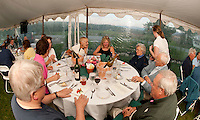 """Paul and Renee Speltz, Jennifer Gentry, Janet Englund, Karen Chapman, Mary and Bud Gates and Gary Chapman are served appetizers by Aberdine Donaldson at Moulton Farms """"Taste of the Farm"""" dinner overlooking the Ossipee Mountains Tuesday evening.  (Karen Bobotas/for the Laconia Daily Sun)Taste of the Farm dinner by Moulton Farm Tuesday, August 16, 2011."""