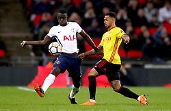 Tottenham Hotspur's Davinson Sanchez (left) and Watford's Andre Gray battle for the ball